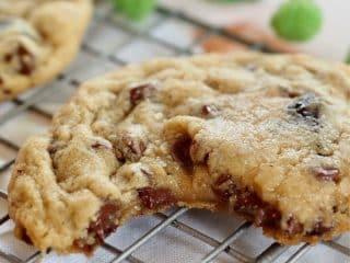 Chewy Gooey Chocolate Chip Cookie broken in half with gooey center showing.