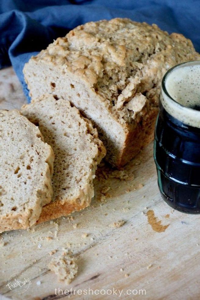 sliced beer bread with a mug of dark beer | via @thefreshcooky