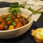 This recipe for Beer Beef Stew is so delicious, easy and versatile! Chunks of fall apart beef, winter vegetables that are fork tender, swimming in a delicious beef gravy. Use your leftovers to make Shepherd's Pie. Comfort food for a chilly Sunday supper! #thefreshcooky #beefstew #beer #stew #sundaydinner #comfortfood