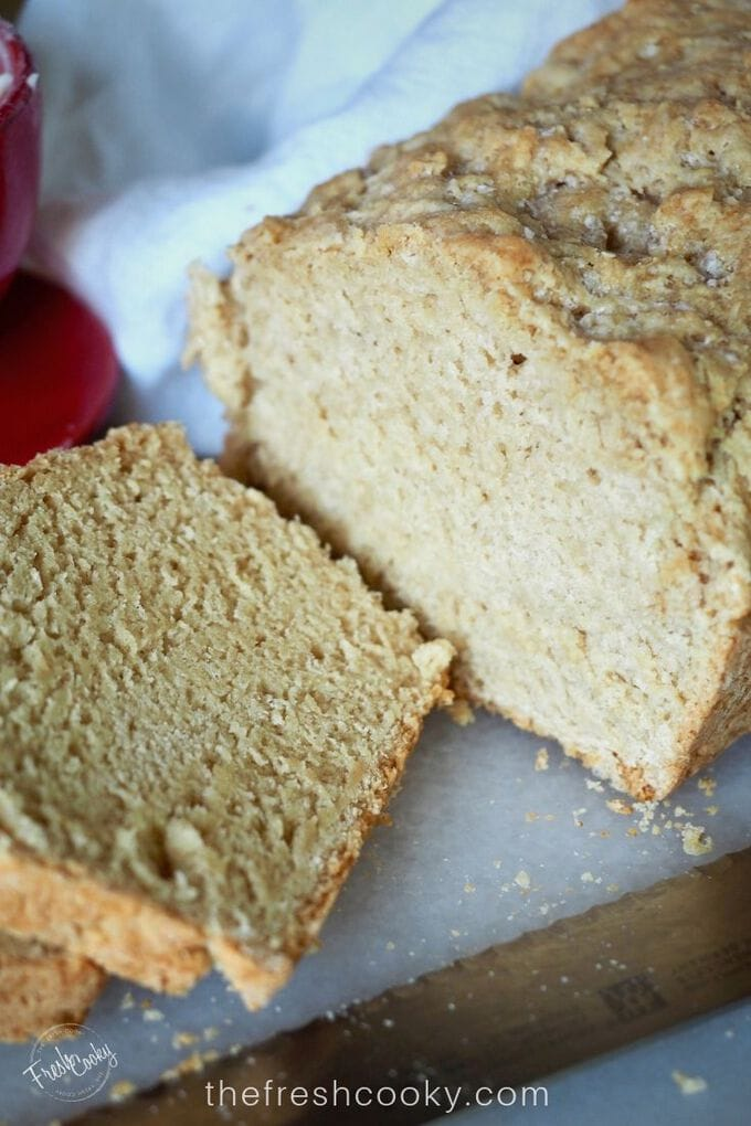 Close up image of sliced beer bread with loaf and a few slices.