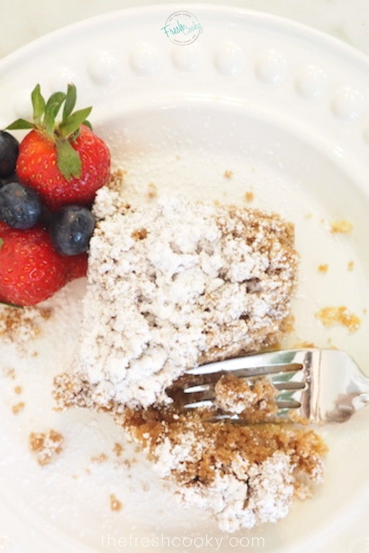 Plated piece of Starbucks Copycat Coffee Cake with a strawberry and fork.
