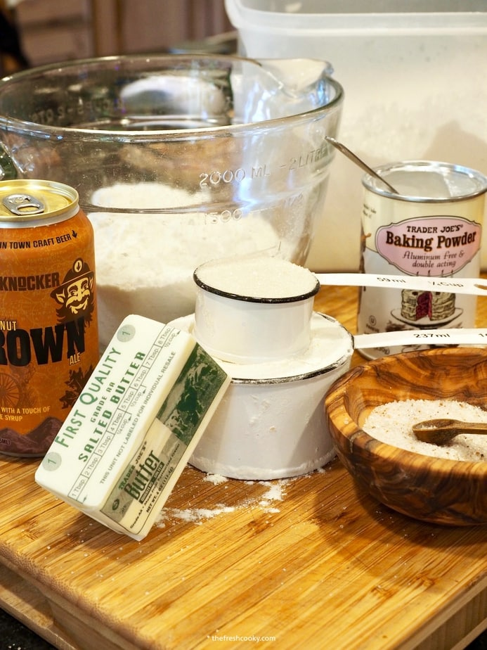 Ingredients for Beer Bread. Left to right. Beer, Flour, baking powder, salt, sugar and butter.