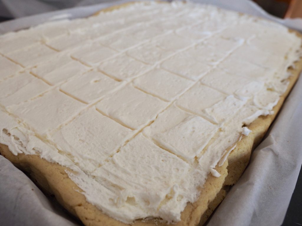 This is the BEST Sugar Cookie Bars recipe! This recipe is easy and fast and feeds a crowd and who doesn't love a sugar cookie bar?? They're chewy, soft and tender and piled mile high with the creamiest buttercream sugar cookie frosting EVER. #thefreshcooky #softsugarcookies #sugarcookiebars #chewy #barcookies
