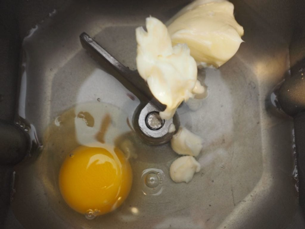Water, butter and egg in bottom of bread machine pan.