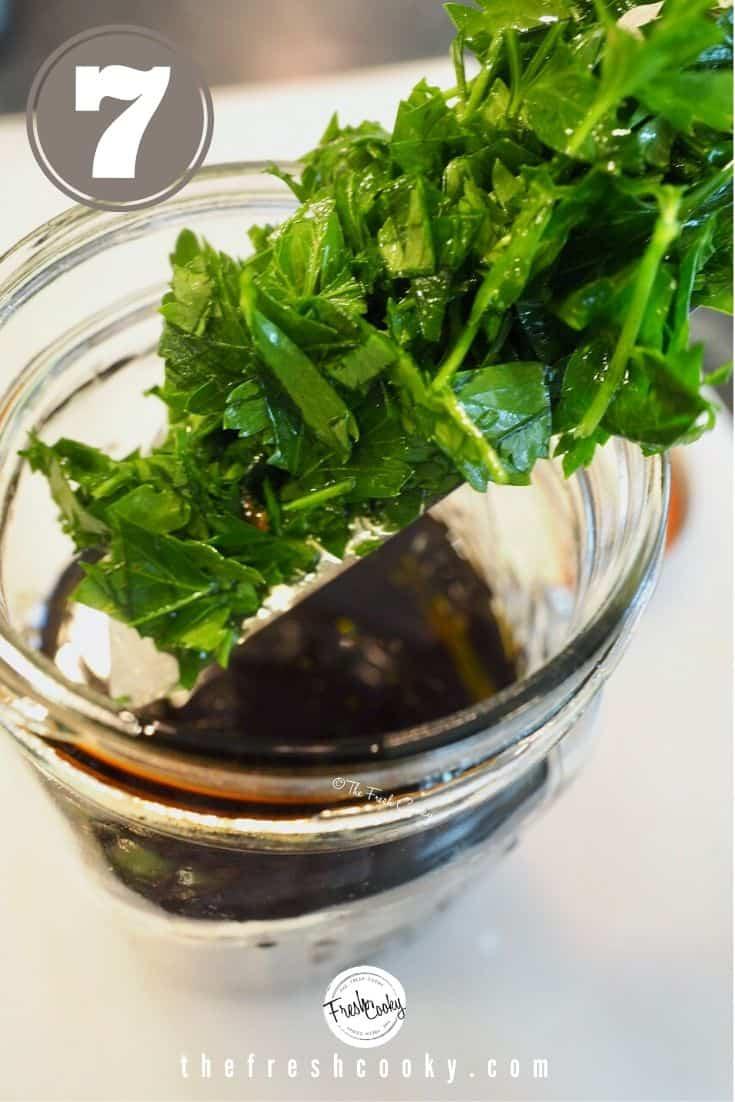 process shot, adding fresh chopped parsley