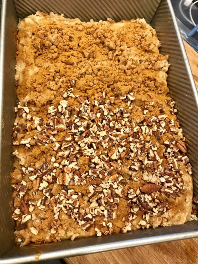 Crumbs spread on top with half covered in chopped pecans for Gluten Free Coffee Cake | www.thefreshcooky.com