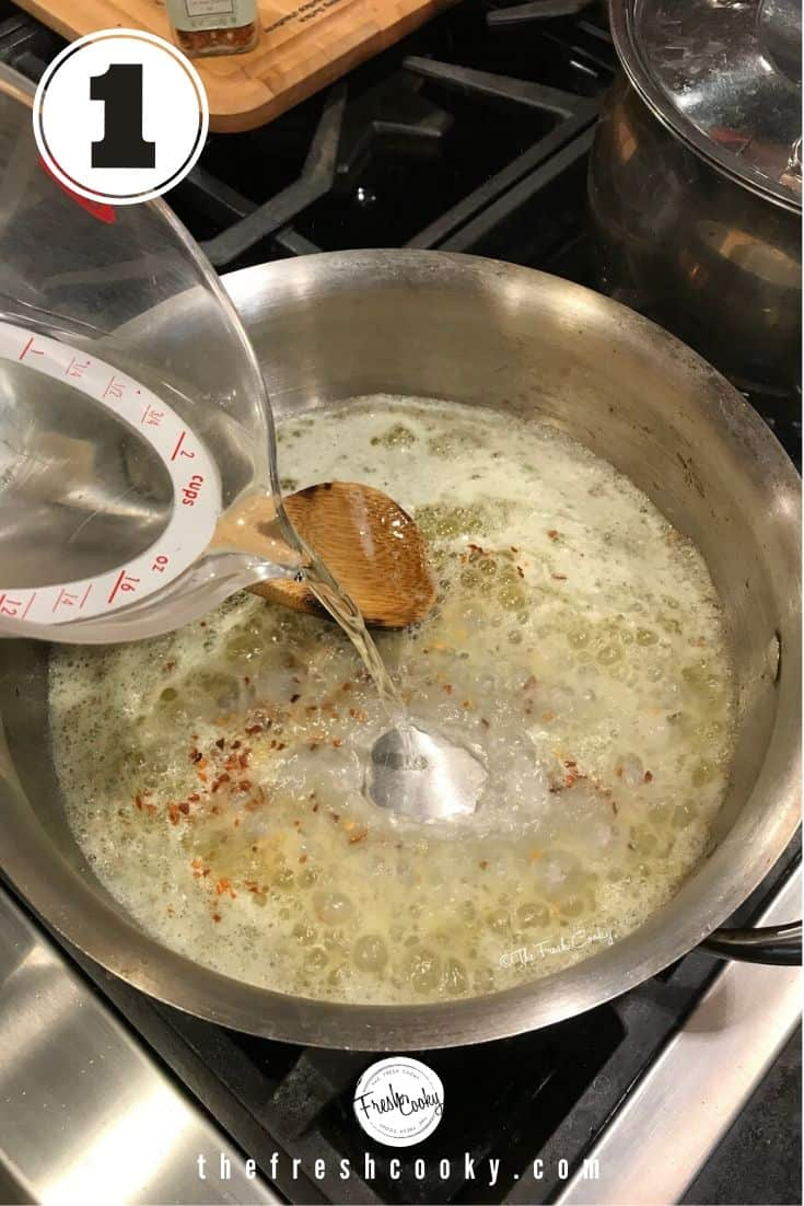 pouring vodka into pan with melted butter and red pepper flakes