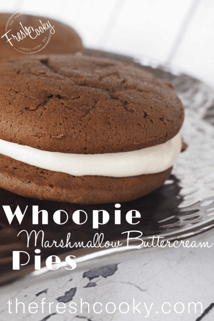 Classic New England Whoopie Pies. Chocolate cakey outside, sandwiching an amazing, gooey, marshmallow buttercream filling. The perfect sandwich cookie, uh pie! #thefreshcooky #whoopiepie #handpies #sandwichcookie