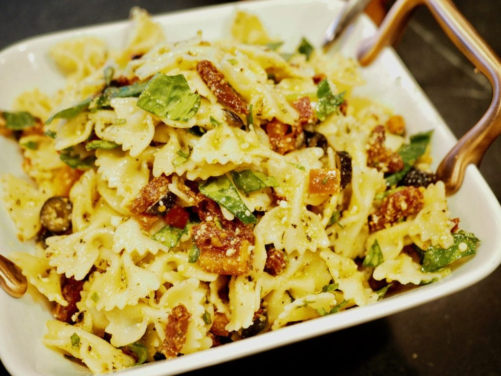 Sun-Dried Tomato Pasta Salad is full of fresh veggies, basil and spinach with a light Italian dressing. #pastasalad #sundriedtomato #makeahead #picnic #potluck #bbq #salad