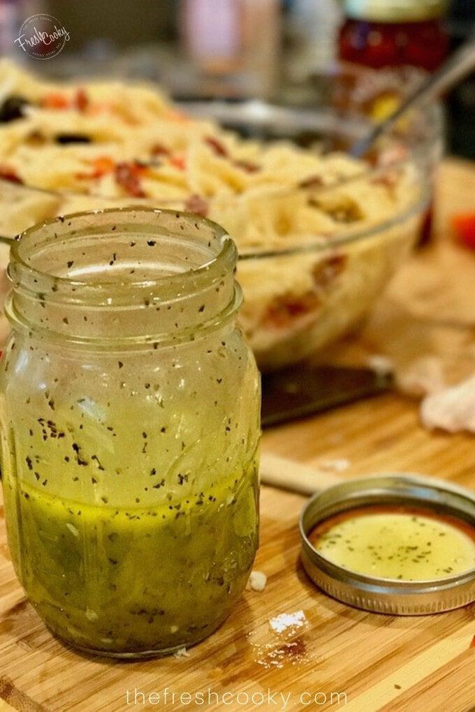 Shaken white balsamic vinaigrette in mason jar.