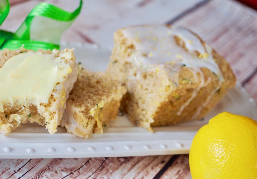 Lemon Zucchini Bread slices on plate with lemon and green ribbon in background. | www.thefreshcooky.com