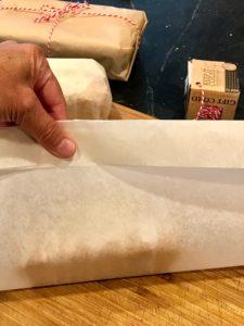 folding parchment onto quickbread | www.thefreshcooky.com