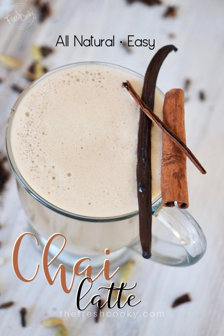 Pin for Chai Tea Latte with image of glass mug filled with chai latte with spices sprinkled around and a cinnamon stick on top