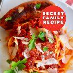 Homemade Tomato Sauce with plate of spaghetti and Italian sausage.