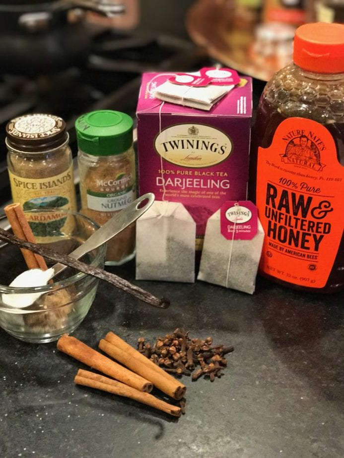 Ingredient image for Chai Tea Latte, L-R Cardamom, Nutmeg, Darjeeling Tea, Ra Honey, Vanilla Bean, Cinnamon Stick, Cloves, Ginger