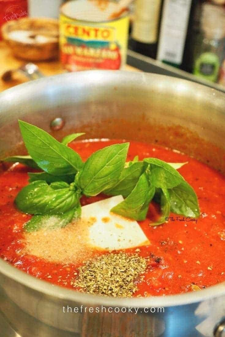 Seriously, the BEST! This Spaghetti Sauce recipe has been passed down from my restaurant owning, Italian Grandpa! Loaded with San Marzano tomatoes, roasted garlic, fresh basil, and other herbs and spices. Make it today, use it over pasta, meatball subs, lasagna or for calzone dipping! #thefreshcooky #spaghetti #pasta #homemade #best