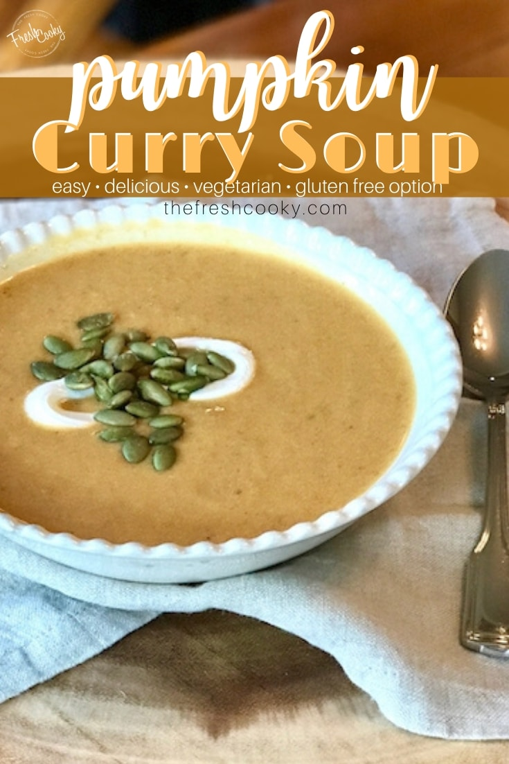 Pin for pumpkin curry soup with pretty bowl filled with pumpkin curry soup and garnished with pepitas and creme fraiche.