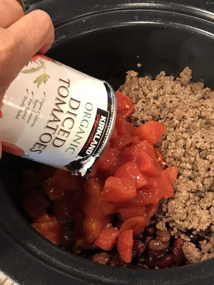 ADDING DICED TOMATOES TO GROUND BEEF