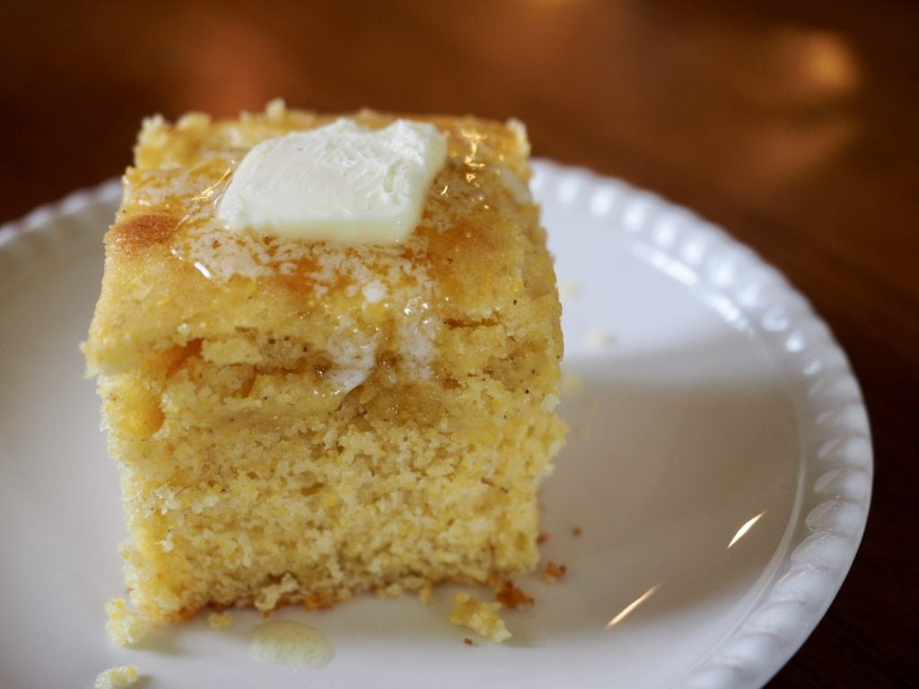 slice of cornbread with butter pat melting on top | www.thefreshcooky.com