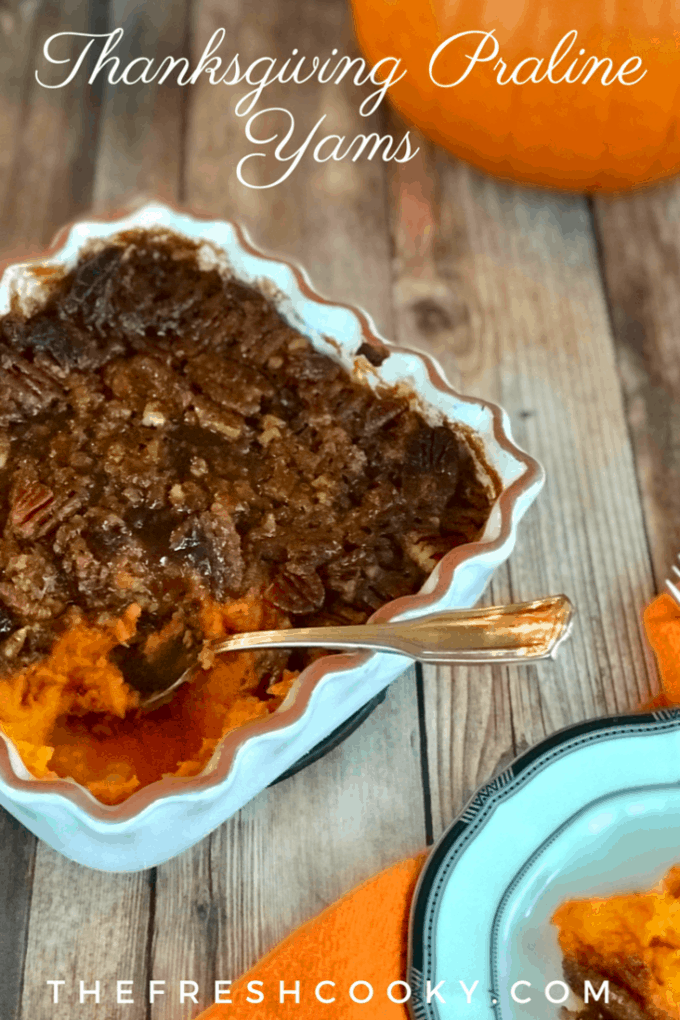Delicious, simple and oh so yummy. This recipe for Thanksgiving Praline Yams has a crisp, buttery, pecan praline atop creamy, whipped yams (or sweet potatoes) with lively and bright flavors like orange juice and zest, ginger, and whiskey. A family favorite. #thefreshcooky #thanksgiving #yams #praline #sweetpotatoes #sides #holidaysides #mealplanning #makeahead