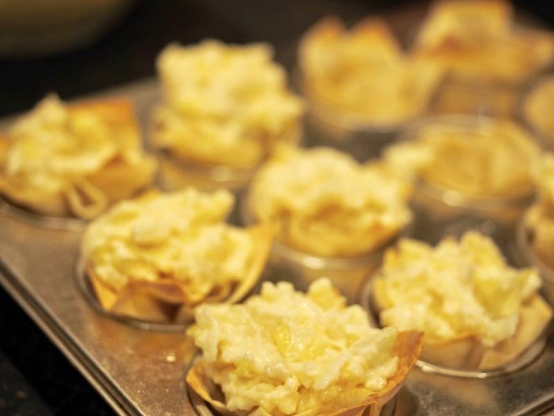 Artichoke cheese filling in baked wontons in mini muffin pan. Artichoke Cheese Wontons | www.thefreshcooky.com