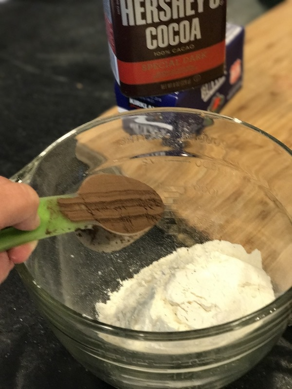 Tossing dark cocoa powder into flour | thefreshcooky