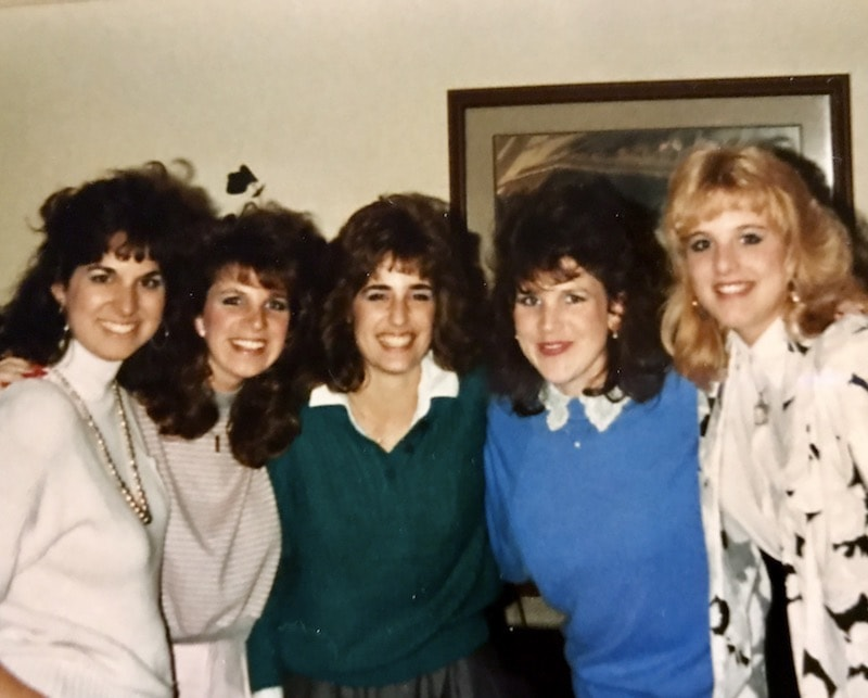 Picture of all of the same friends back in the 80's, big hair and all.