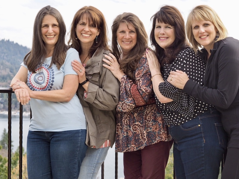 Lisa, Kathleen, Julie, Shaw, and Dawn standing on a railing, best of friends since the late 70's