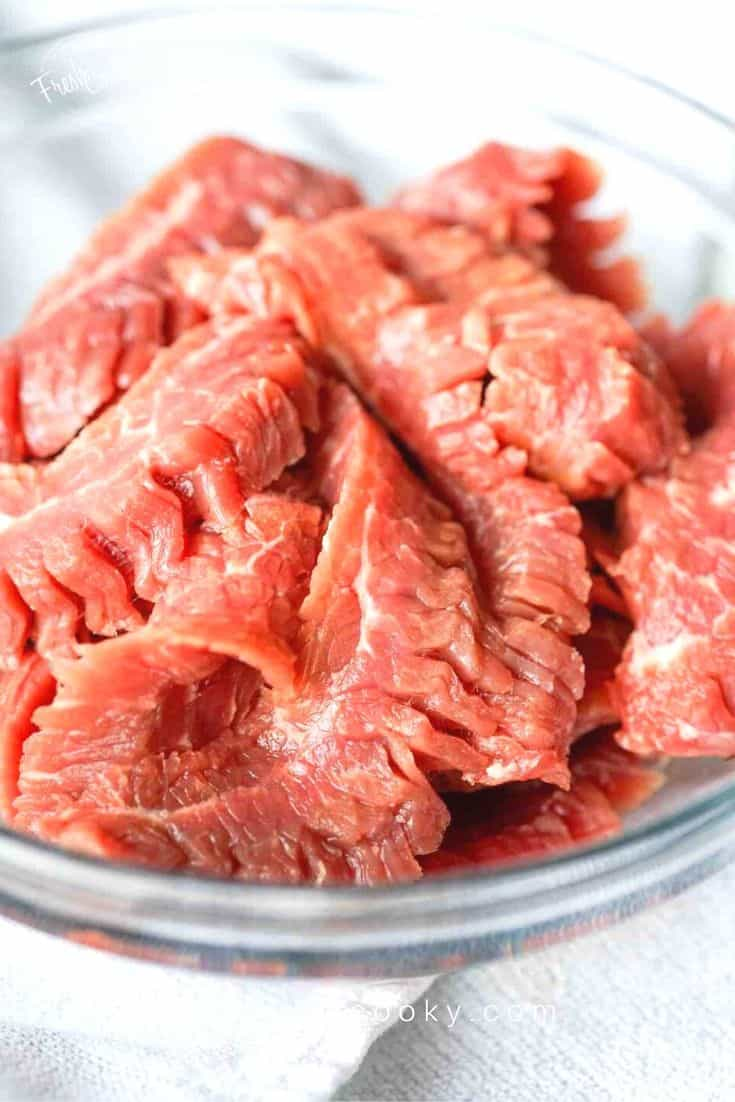 sliced steak, ready for stir fry with beef and broccoli | thefreshcooky.com