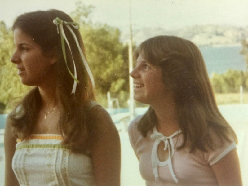 Kathleen and Julie, back in late 70's with lake in background.