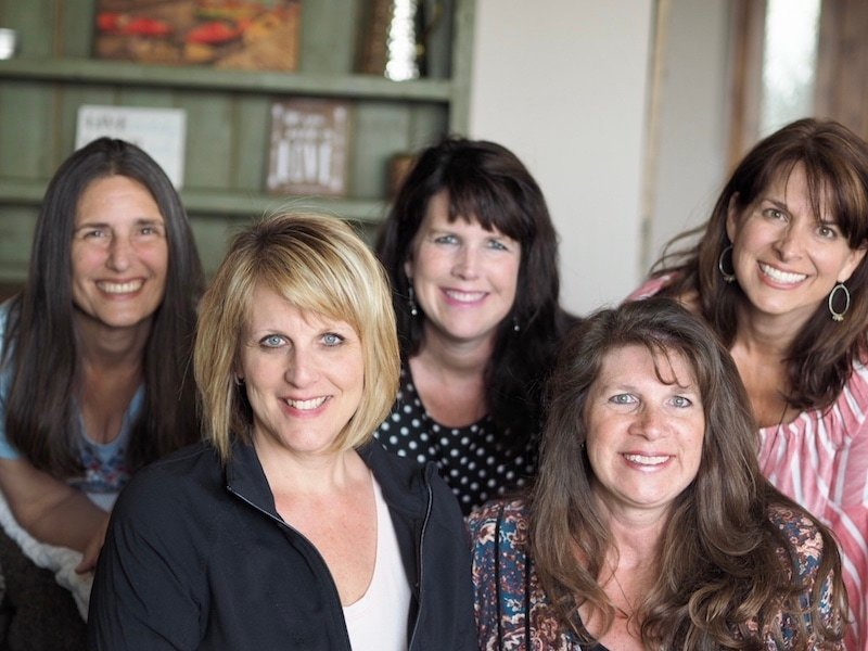 Five women in a photo, smiling, friend since teen years. Lis, Shawn, Kathleen, Dawn and Julie