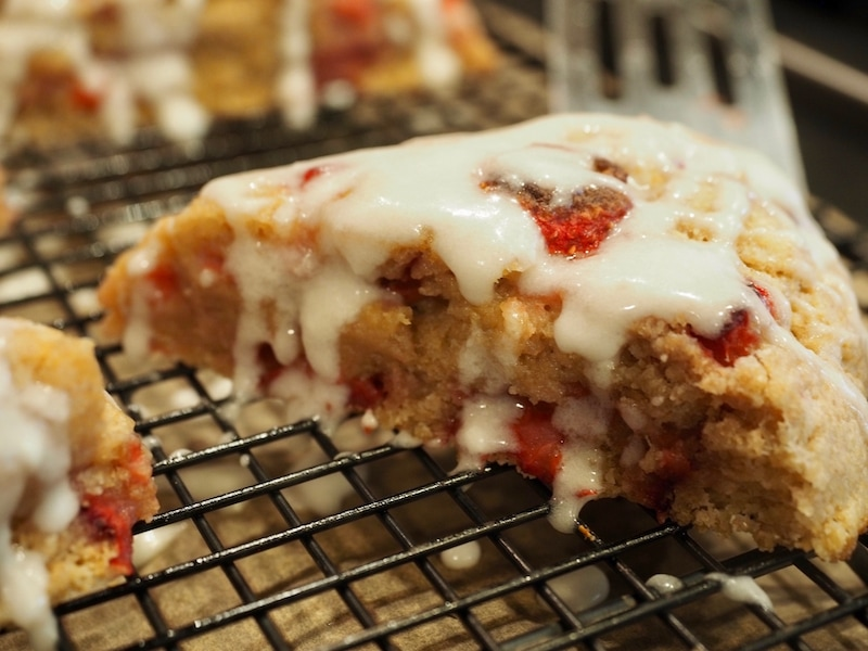 lemon glaze dripping off strawberry scones | www.thefreshcooky.com