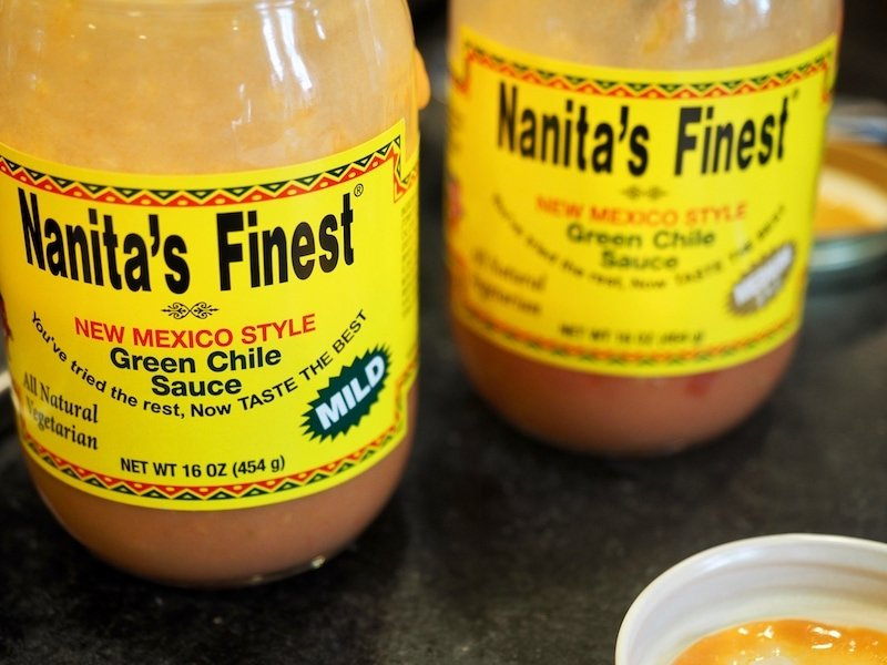 Image of jars of Nanita's Finest New Mexico Style Green Chile sauce on counter