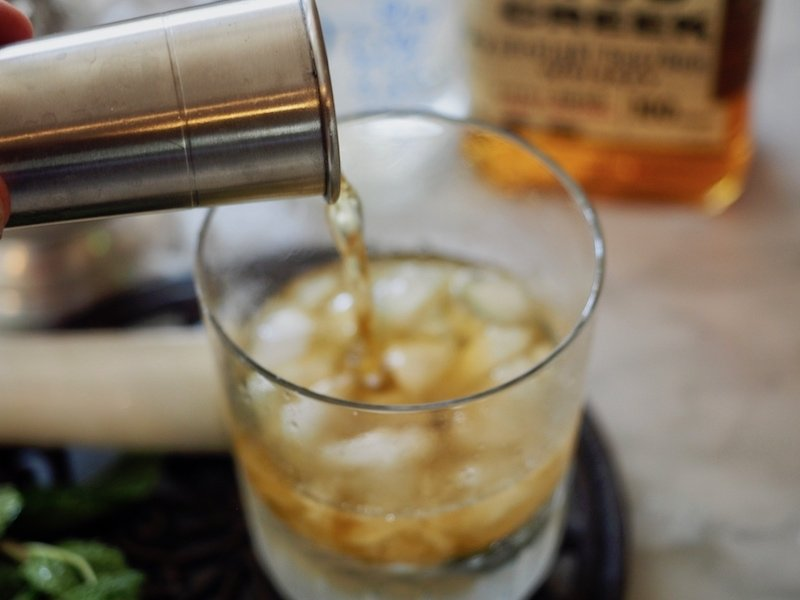 Pouring Bourbon for Cocktail | Mint Julep The Fresh Cooky
