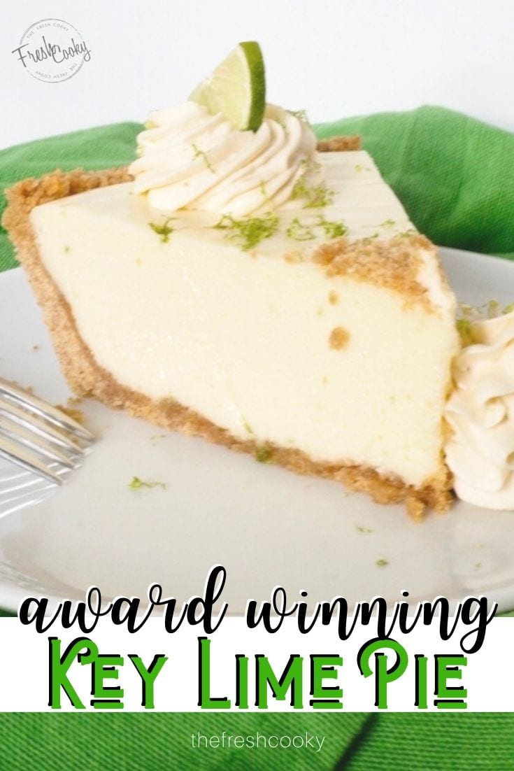 Pinterest image for award winning key lime pie with piece of pie on plate with fork and whipped cream decor.