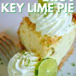 Best ever key lime pie with wedige of Key Lime Pie on white plate with fluffy dollops of whipped cream and slices of fresh lime.