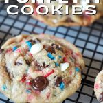 Pinterest image for Cake Mix Funfetti Cookies with close up of red, white and blue funfettit cookie on a wire cooling rack.