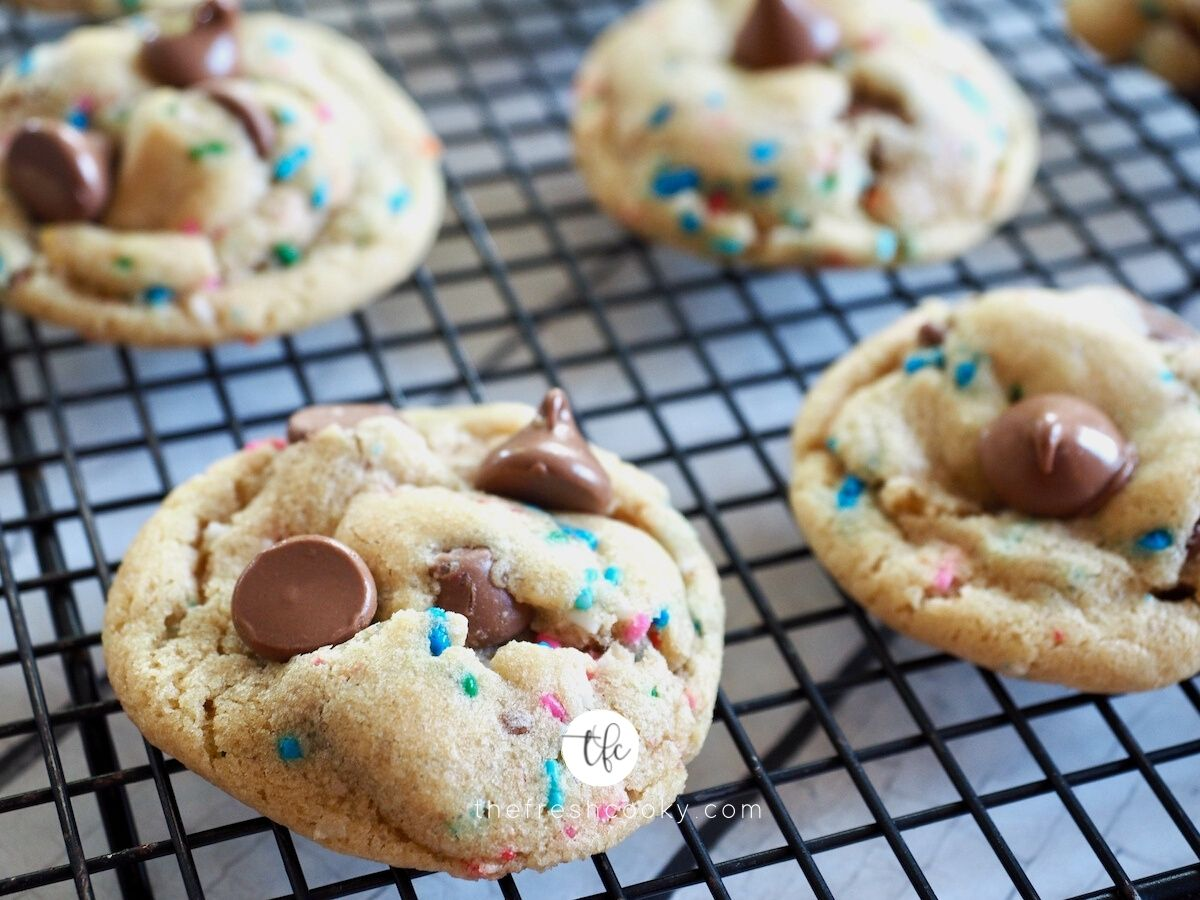 Cake batter chocolate chip cookies on a wire cooling rack.