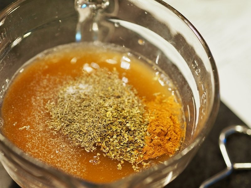 Seasonings and broth for Barbacoa meat in mixing bowl | www.thefreshcooky.com