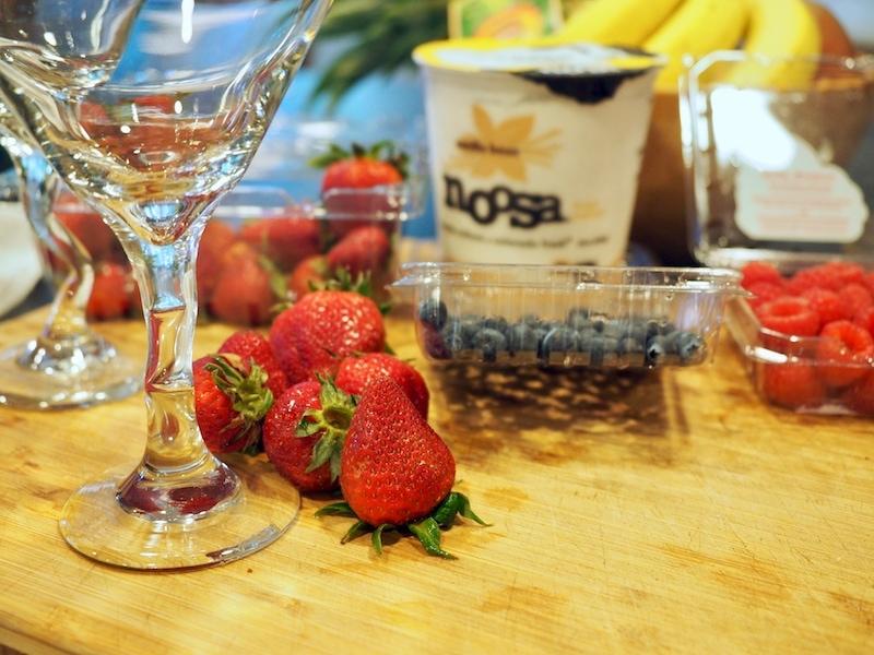 Ingredients for red, white and blue yogurt parfaits. L-R Strawberries, blueberries, raspberries and vanilla Noosa yogurt.