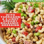 Close up of bacon macaroni salad with bacon and a bit of fresh tarragon on the side.