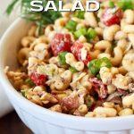 Bacon balsamic ranch macaroni salad with white bowl and tarragon.
