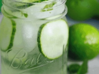 Spa water for adults! This 21+ Cucumber Cooler is so light, crisp and refreshing, filled with crunchy cucumbers, and the option of refreshing mint or earthy basil. Enjoy it after a hot afternoon playing outside or sipping with your girlfriends. #thefreshcooky #cucumbercooler #cocktail #mocktail #ginandtonic #mint #basil #lime