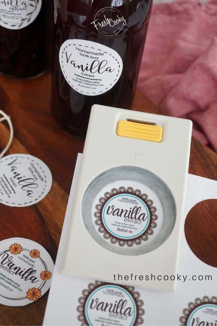 "sheets of vanilla labels with a 2"" punch punching out the label"