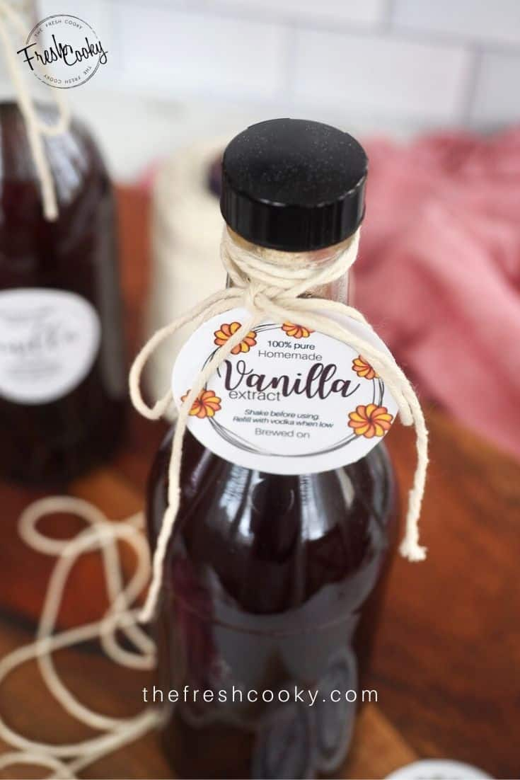 small bottle of vanilla extract tied with twine and a round label saying Vanilla Extract tied on.