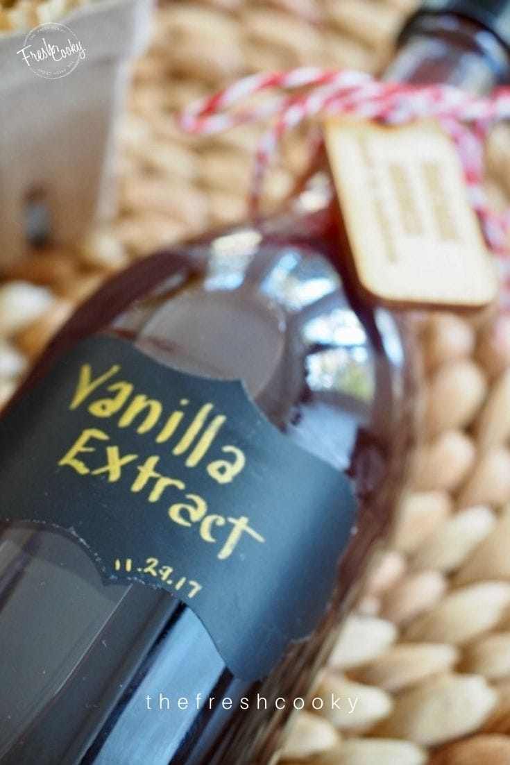 Bottle of vanilla extract with label laying down on rattan background with brewed on date 11.29.17
