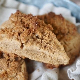 These Cinnamon Crunch Scones are a buttery, tender whole-grain, cream scones that are full of sweet cinnamon flavor and not the least bit dry. The Cinnamon Crumb Crunch topping is the best part! Perfect for a morning tea, breakfast or brunch or an afterschool snack! #thefreshcooky #scones #cinnamonscones #crumbtopping #brownsugar #fallbaking #recipe