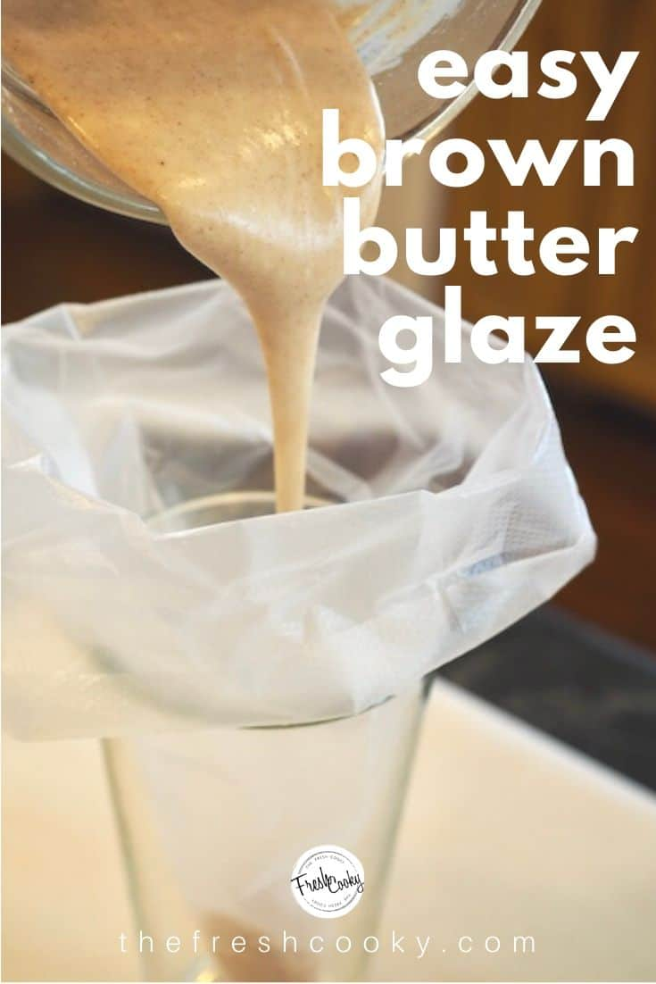 A tall glass with a piping bag folded over with brown butter glaze being poured inside of bag.