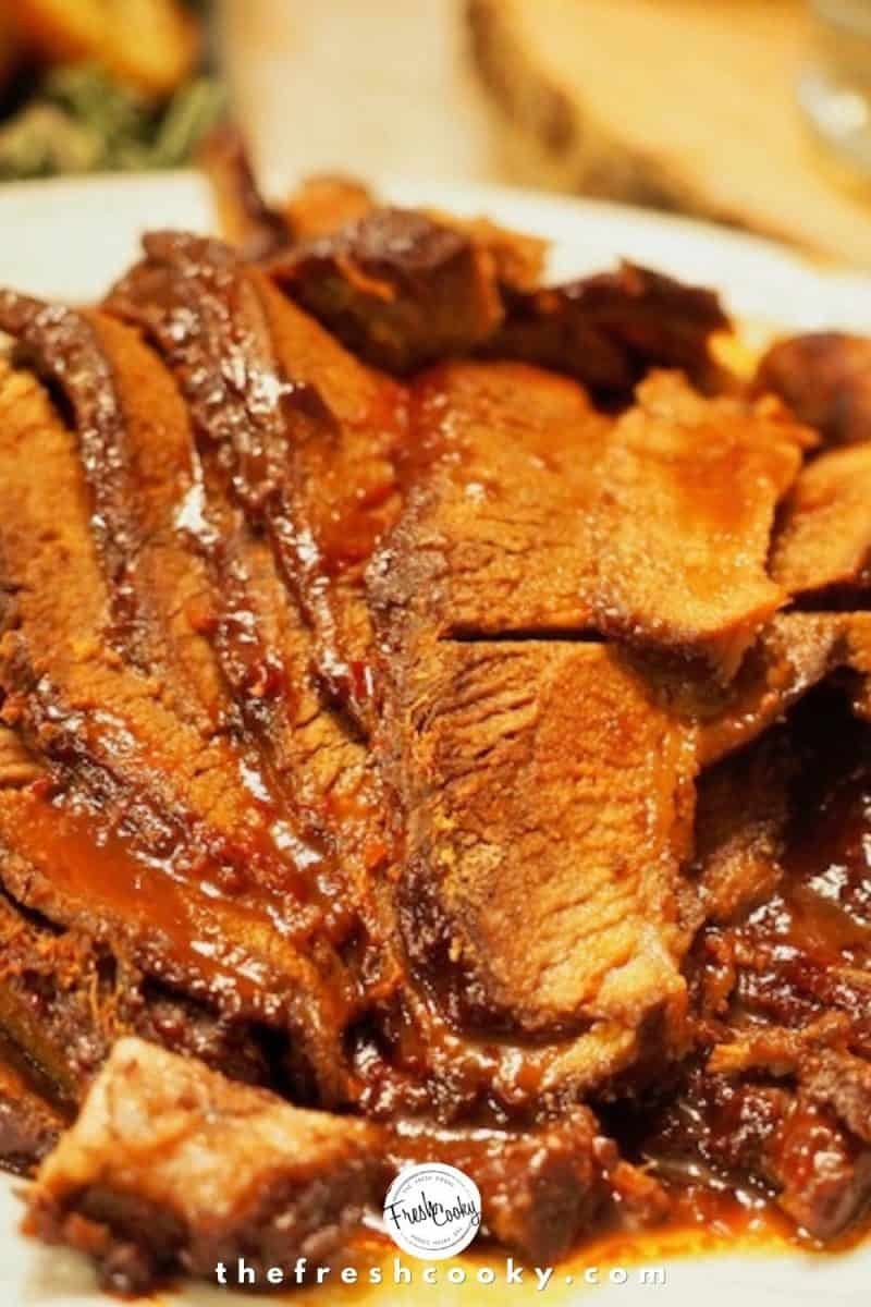 white plate of sliced barbecue beef brisket.
