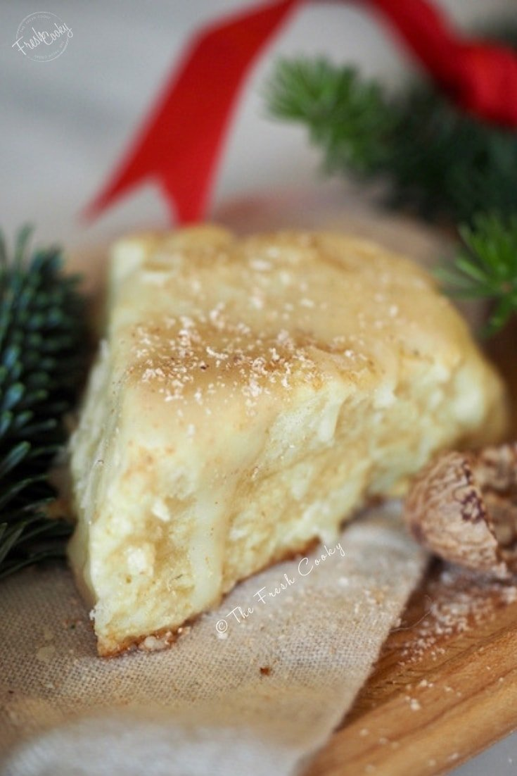 eggnog scone with greenery behind |thefreshcooky.com